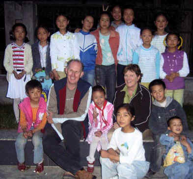 Jan and Ian with school kids in Xiaojin
